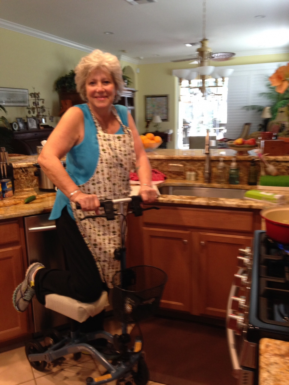 Kathy on the Swivelmate Knee Walker from Naples Florida March 2015