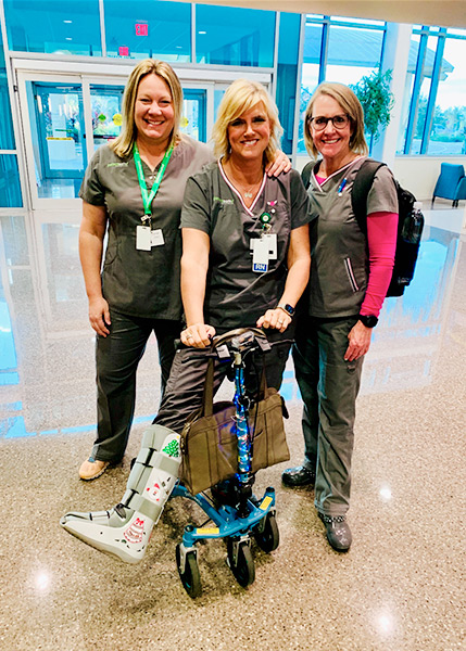 nurse using a knee scooter