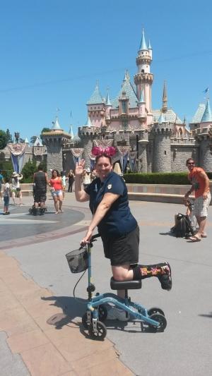 Kimberly going to Disneyland on her knee walker