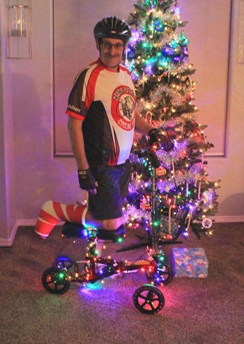 man on Christmas knee scooter