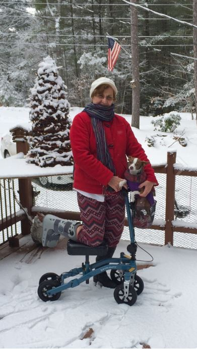 Woman on knee scooter in the snow