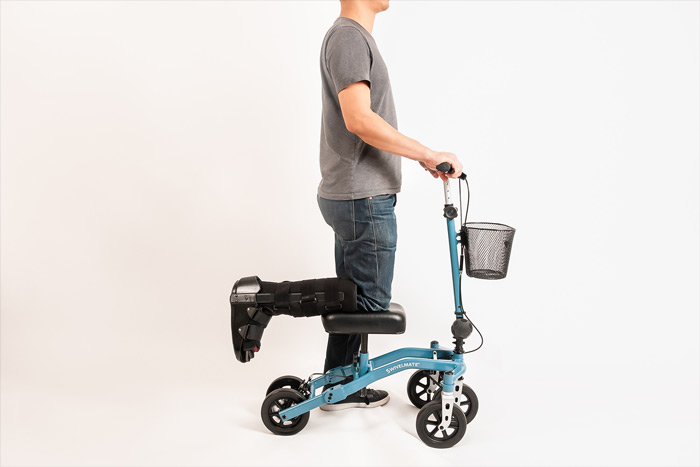man using a knee scooter