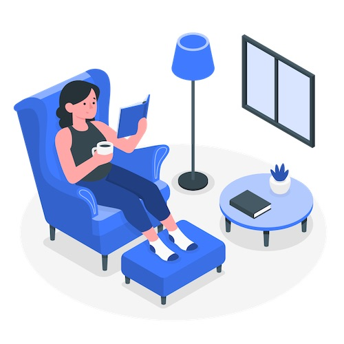 woman at home relaxing reading a book and drinking coffee