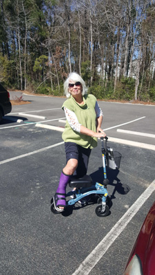 Woman on Swivelmate Knee Scooter