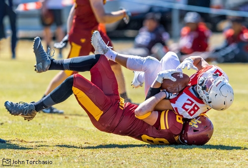 Football player getting tackled to the ground