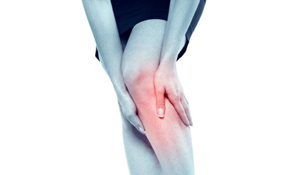 Woman Grabbing Knee