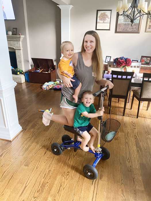 mom and kids on knee scooter