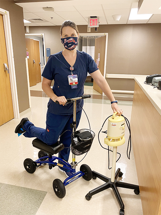 nurse on a knee scooter