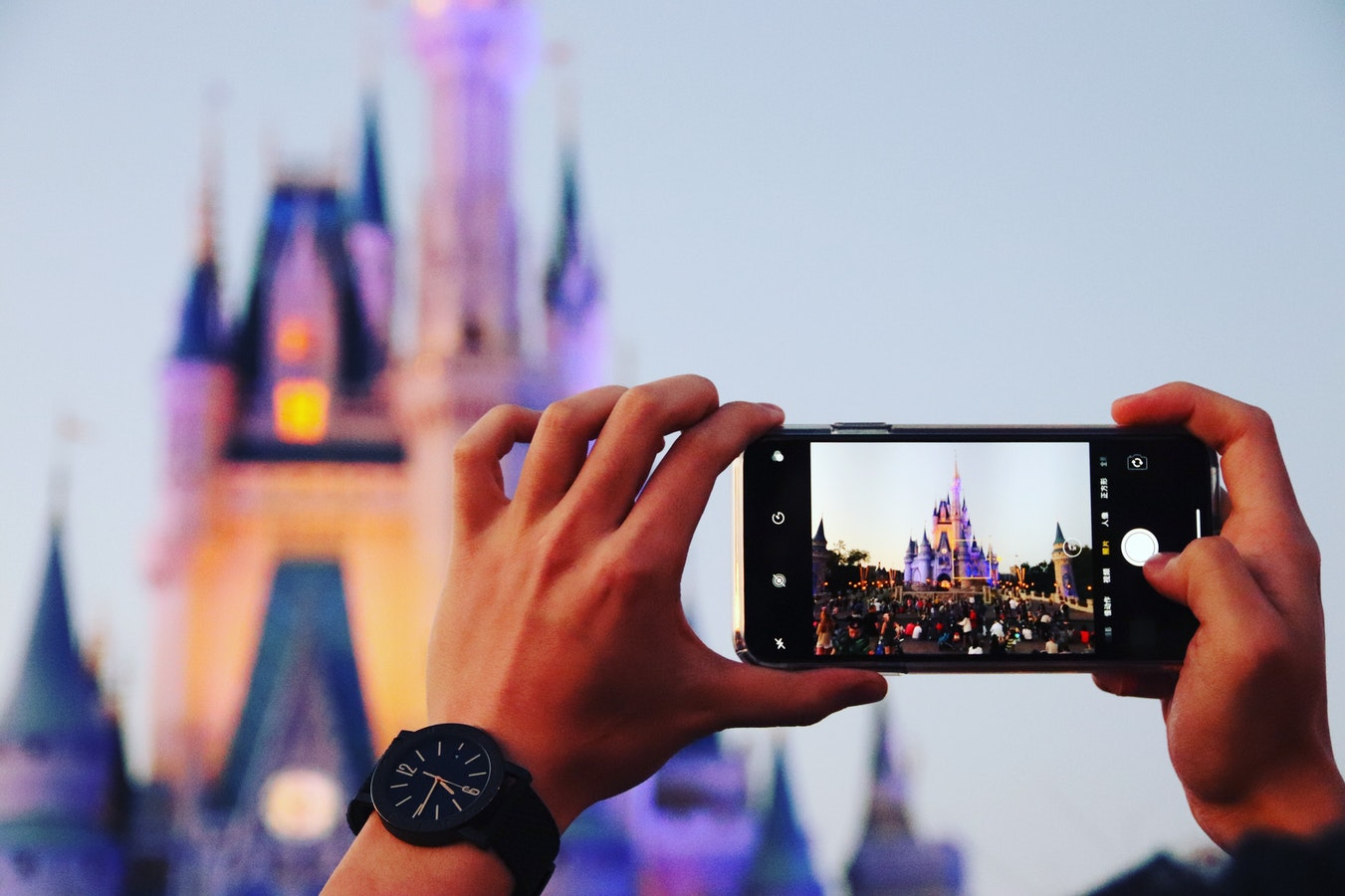 taking picture of Disney castle