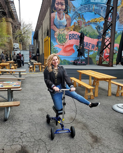 lady outdoors on a knee scooter